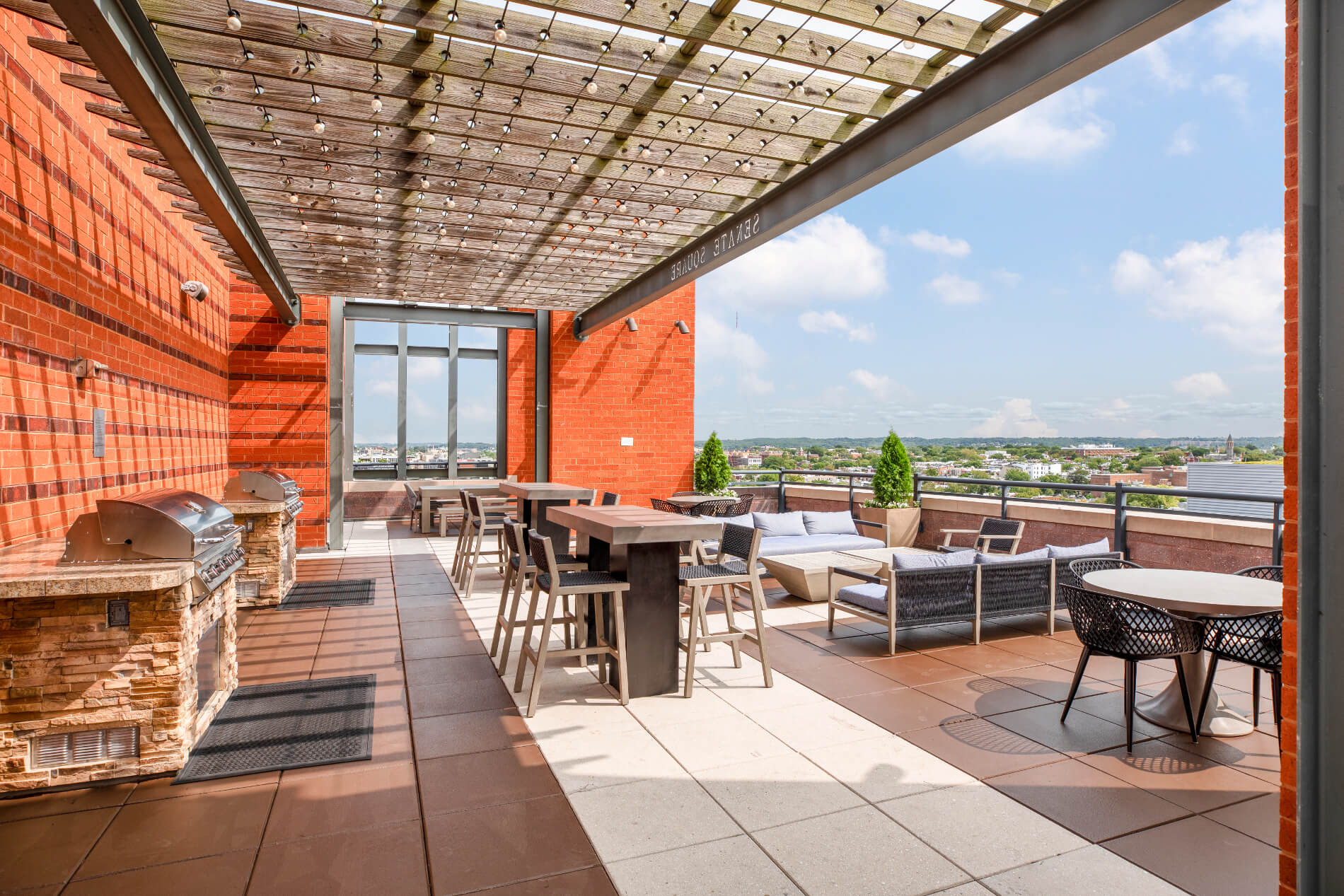Grilling stations with a variety of tables and chairs overlooking the city