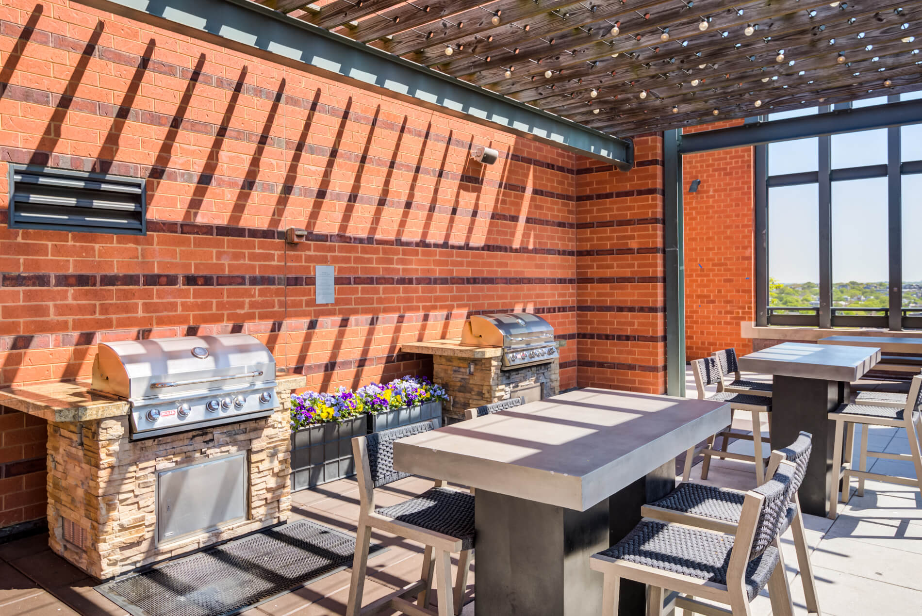 Two grilling stations with adjoining tables