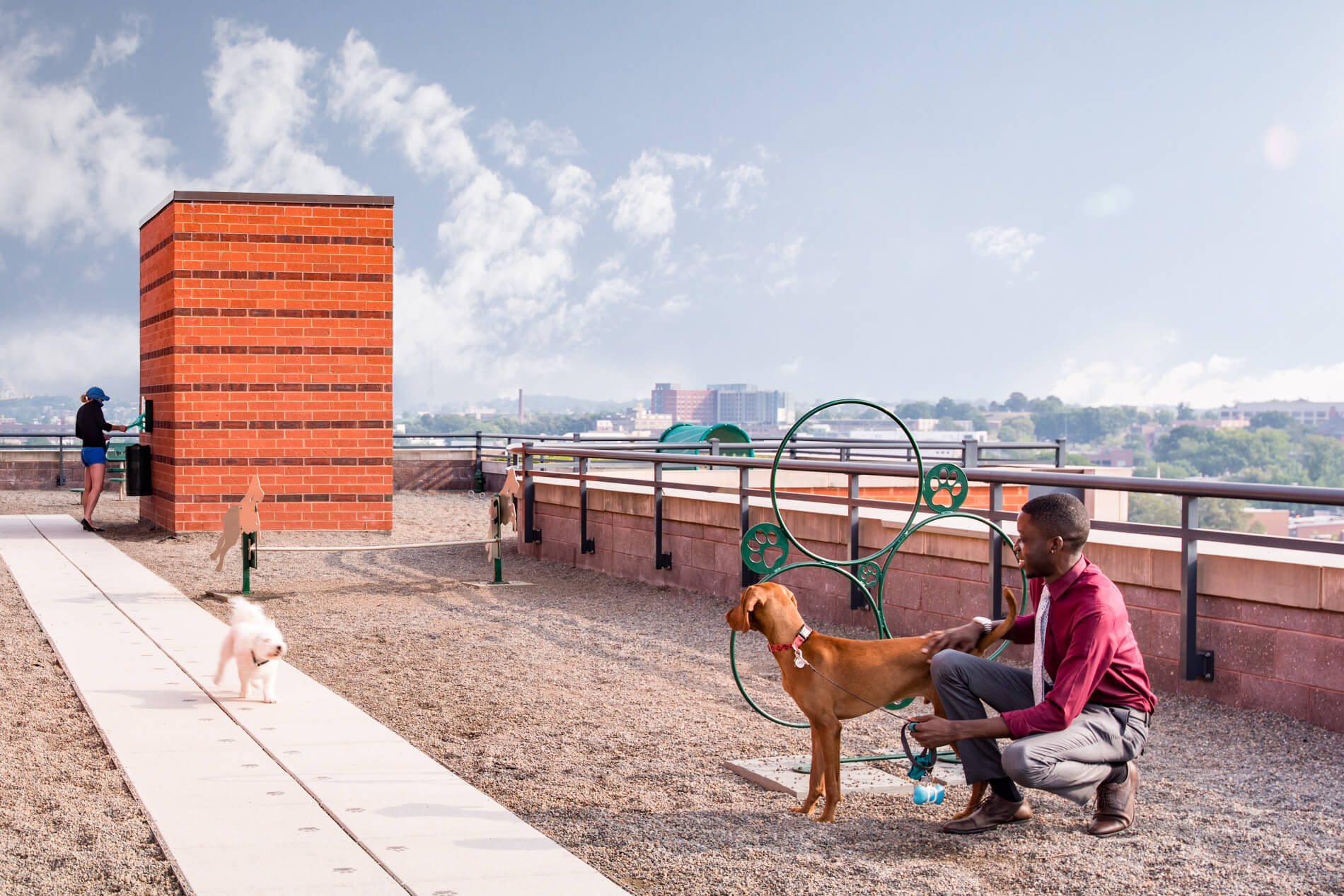 Pebbled rooftop dog park with waste station