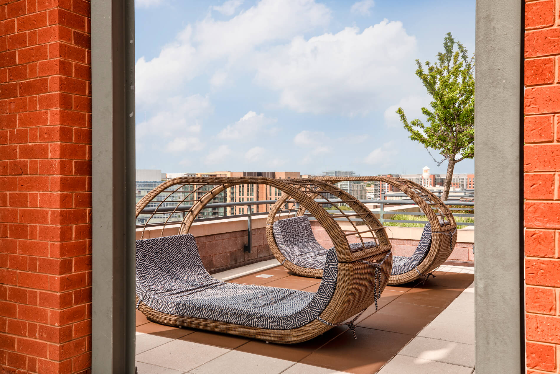 Rooftop wicker chairs in the shape of pods with large cushions