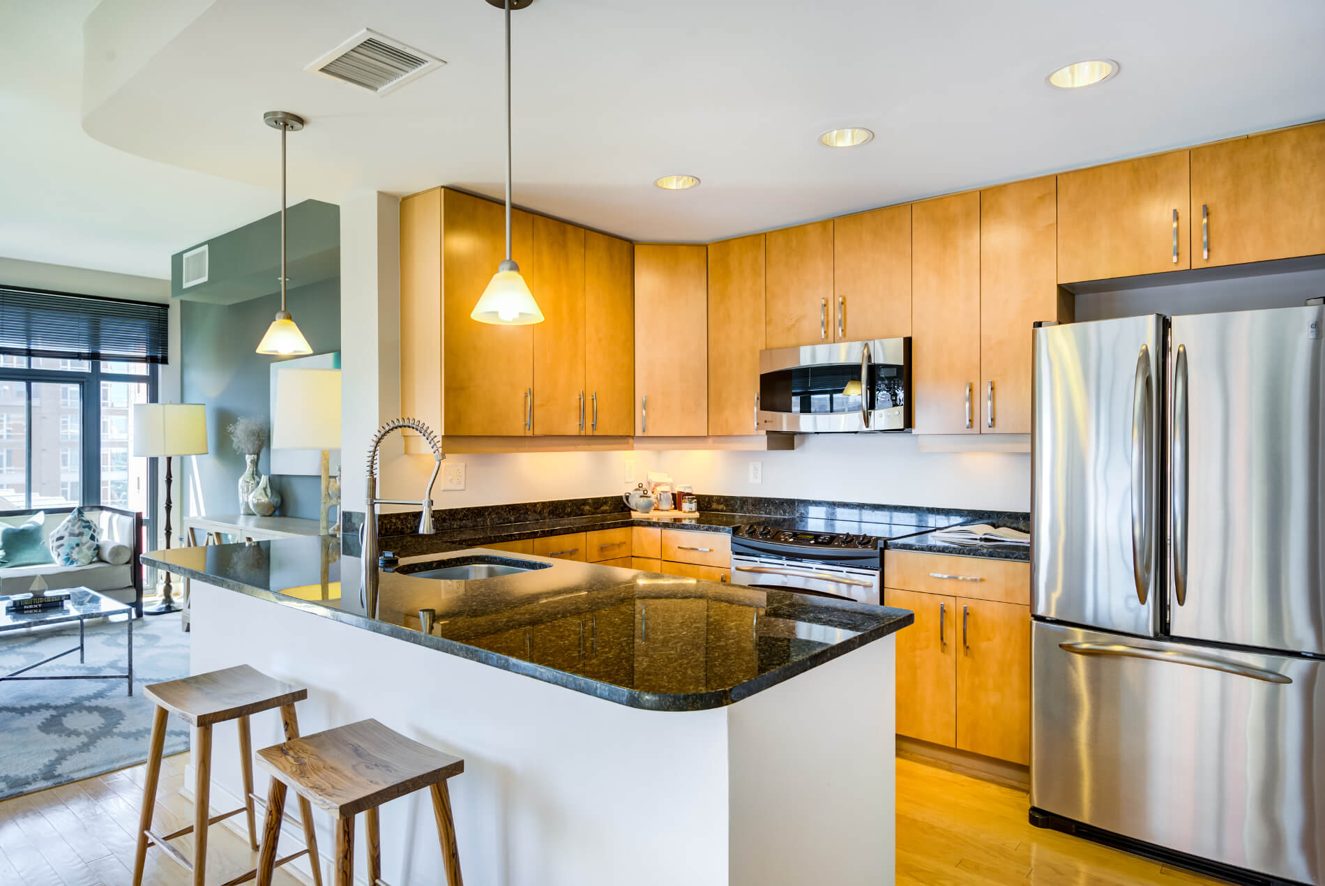 Kitchen with open layout, island and stainless-steel appliances
