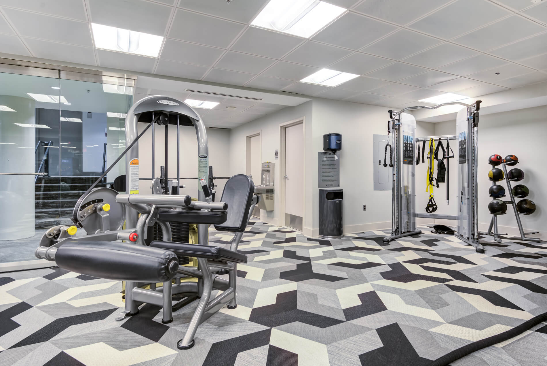 Medicine balls and cable fitness in well lighted gym
