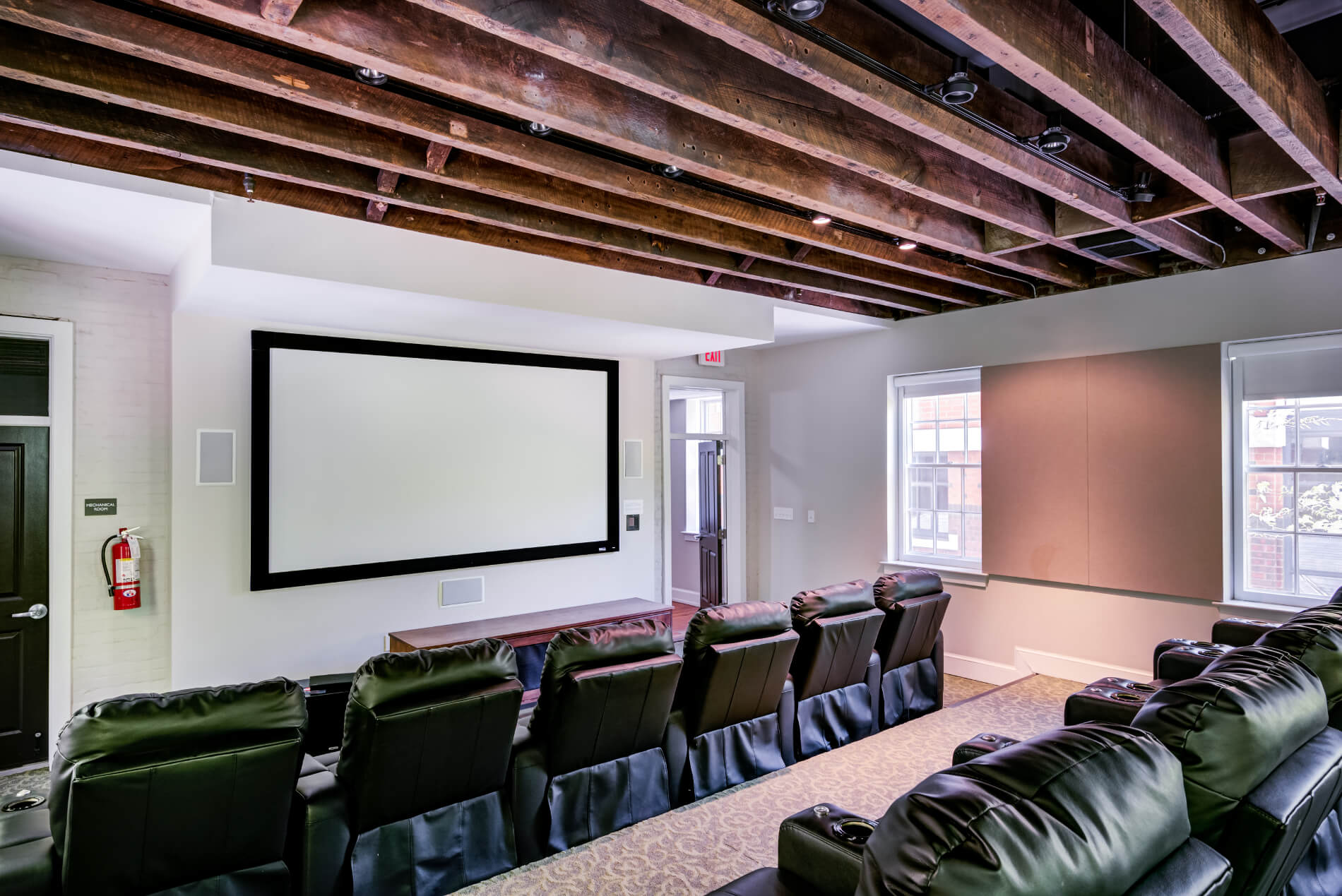 Theater with big screen, and tiered recliner-style seating