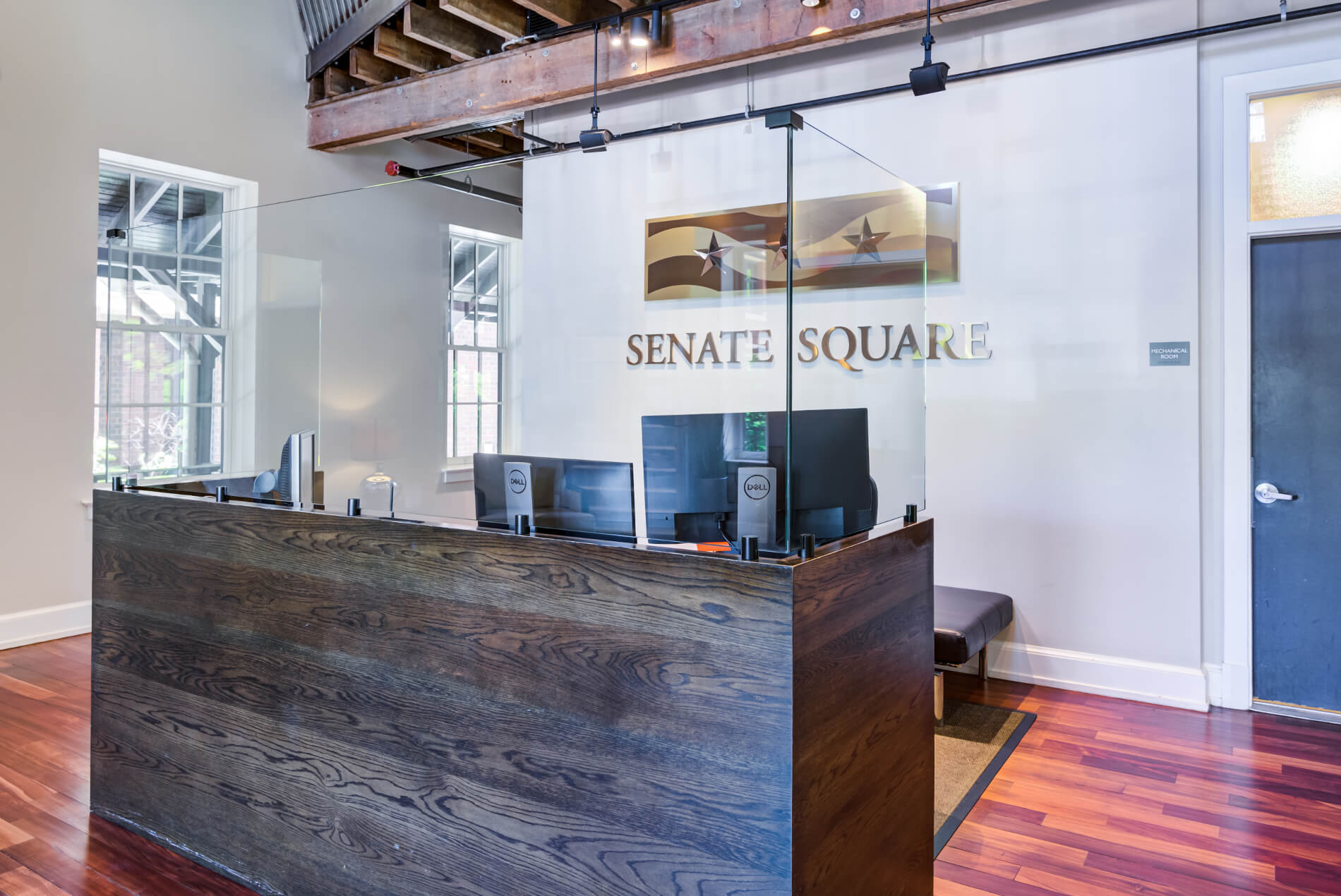 Lobby with concierge desk and Senate Square logo wall art
